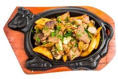 Вкусное зажаренное в духовке мясо свинины с западными картошками стоковое фото