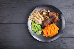 Вкусное тушёное мясо цыпленка с пюрем тыквы Стоковые Изображения