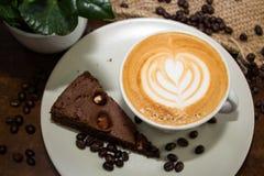 Вкусное browny с чашкой кофе Стоковые Изображения