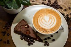 Вкусное browny с чашкой кофе Стоковые Изображения RF