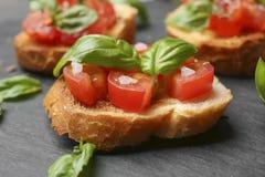 Вкусное bruschetta с томатами Стоковые Изображения