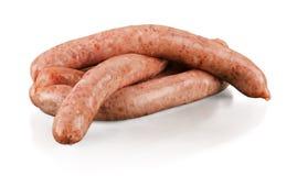 Вкусные зажаренные в духовке сосиски на белизне Стоковые Фото