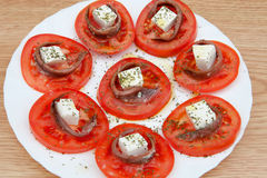 Вкусные куски томата с сыром Стоковая Фотография