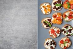 Вкусные bruschettas с томатами Стоковые Изображения RF