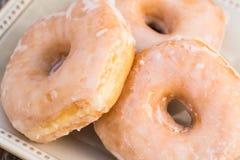 Вкусные Donuts завтрака в ряд Стоковое Фото