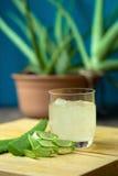 Вкусные macaroons и чашка молока с миндалиной на деревянной предпосылке Стоковая Фотография
