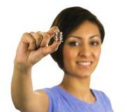 владения монеток этнические штабелируют детенышей женщины Стоковые Фотографии RF