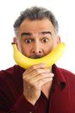 владения стороны банана имитируя человека усмедутся к Стоковое фото RF