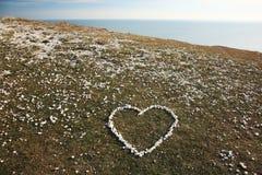 влюбленность сердца сделала камушки Стоковые Изображения
