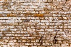 Внешняя кирпичная стена в старом южном городке Стоковое Изображение