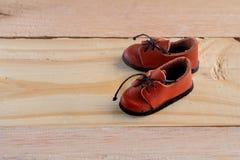 Внешняя модель людей ботинок на деревянном поле jpg Стоковое Изображение