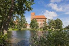 Внешняя часть замка Trakai на времени дня около Вильнюса Стоковое Изображение