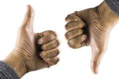 вниз большой пец руки вверх стоковое фото rf