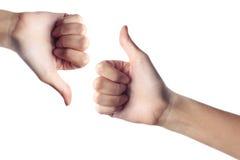 вниз большой пец руки вверх Стоковое Фото