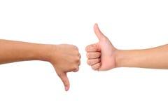 вниз вручите большой пец руки знаков вверх Стоковая Фотография RF