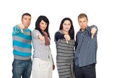 вниз дайте людям группы унылые большие пальцы руки Стоковое Изображение