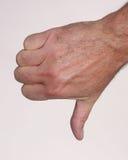 вниз рука делая большие пальцы руки знака Стоковое Изображение RF