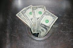 вниз стеките деньги Стоковое Изображение
