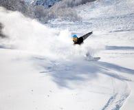 вниз участвовать в гонке snowboarder Стоковые Фото