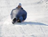 вниз человек холма sledding Стоковые Изображения