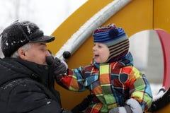 Внук держа нос деда Стоковая Фотография RF