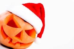 Внутренность тыквы хеллоуина сияющая на белизне Стоковая Фотография RF