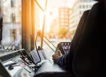 Внутри трамвая с водителем и приборной панелью в заходе солнца Стоковые Фото