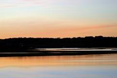 вода захода солнца Стоковые Изображения RF