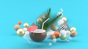Вода кокоса и кокос будут среди красочные шарики на голубой предпосылке стоковое изображение rf