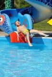 вода скольжения мальчика Стоковые Фотографии RF
