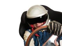 Водитель гоночной машины в шлеме пока управляющ стоковые фото