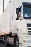 Водитель грузовика и его тележка. Стоковая Фотография RF