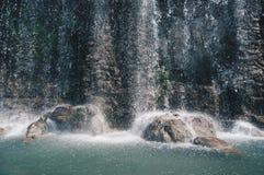 Водопад на холме замка стоковое фото