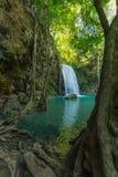 Водопад Erawan с рыбами в воде Стоковые Изображения