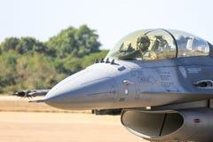 Военный самолёт с пилотом Стоковое Фото
