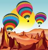 Воздушные шары летания над пустыней стоковое изображение rf