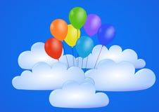 Воздушные шары летают в голубое небо через облака Стоковые Изображения