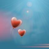 Воздушные шары сердца в небе Стоковое Изображение RF