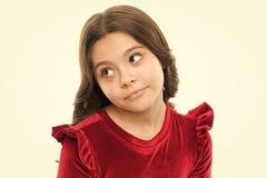 Возможно концепция Сторона ребенк внимательная мечтательная принимает решениее Мысль ребенка милая Взгляд девушки случайный приня стоковая фотография rf