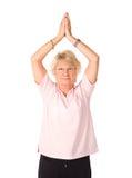 возмужалая йога женщины положения стоковая фотография