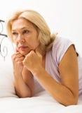 возмужалая унылая женщина Стоковое Фото
