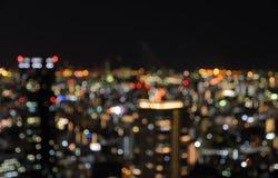 Воздушный взгляд освещения ночи нерезкости городского городского пейзажа Стоковая Фотография RF