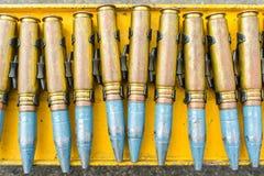Воинские боеприпасы, пуля крупнокалиберного пулемета, знак войны Стоковое фото RF