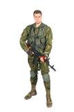 Воинский военнослужащий с винтовкой на белизне Стоковая Фотография