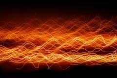 Волна освещает предпосылку Стоковые Фото