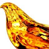Волна предпосылки масла золотая на белой предпосылке Стоковая Фотография