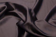 Волнистая предпосылка текстуры крупного плана ткани Стоковое Фото