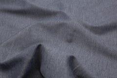 Волнистая предпосылка текстуры крупного плана ткани стоковая фотография