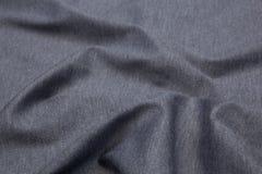 Волнистая предпосылка текстуры крупного плана ткани Стоковое Изображение