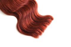Волнистые красные волосы на изолированной белой предпосылке стоковые изображения rf